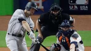 New York Yankees' Brett Gardner hits a single