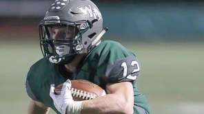 Westhampton's Dylan Laube (12) runs the ball in