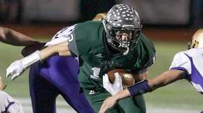 Westhampton's Dylan Laube runs for a first down