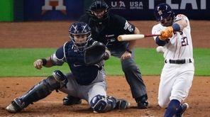 Houston Astros' Jose Altuve hits a two-run scoring