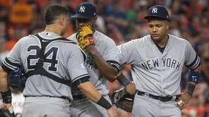 Luis Severino speaks with catcher Gary Sanchez and