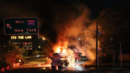 Firefighters respond to a fuel tanker fire on