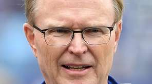 Giants president John Mara looks on from the