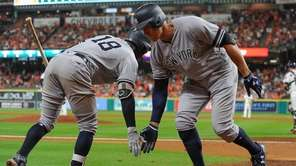 Yankees outfielder Aaron Judge and shortstop Didi Gregorius celebrate during