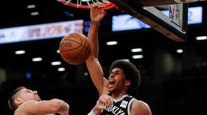 Nets center Jarrett Allen dunks on Magic center Nikola Vucevic during