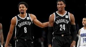 Nets guard Spencer Dinwiddie and forward Rondae Hollis-Jeffersoncelebrate