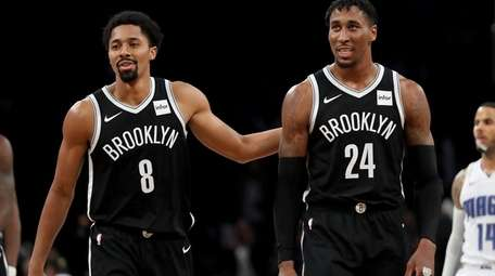 Nets guard Spencer Dinwiddie and forward Rondae Hollis-Jefferson celebrate