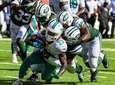 The Jets defense tackles Dolphins running back Jay
