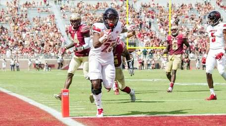 Running back Dae Williams of the Louisville Cardinals