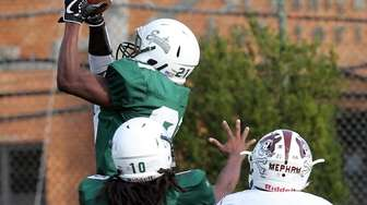Elmont's Michael Djalo gets the interception during a
