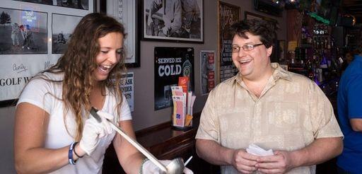 Morgan Weinard, left, serves seafood clam chowder at