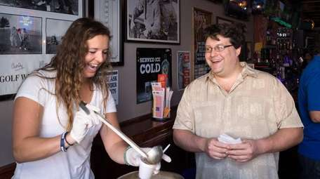 Morgan Weinard, left, serves seafood clam chowder at