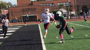 Elmont defeated Mepham, 48-28, in Nassau II football,