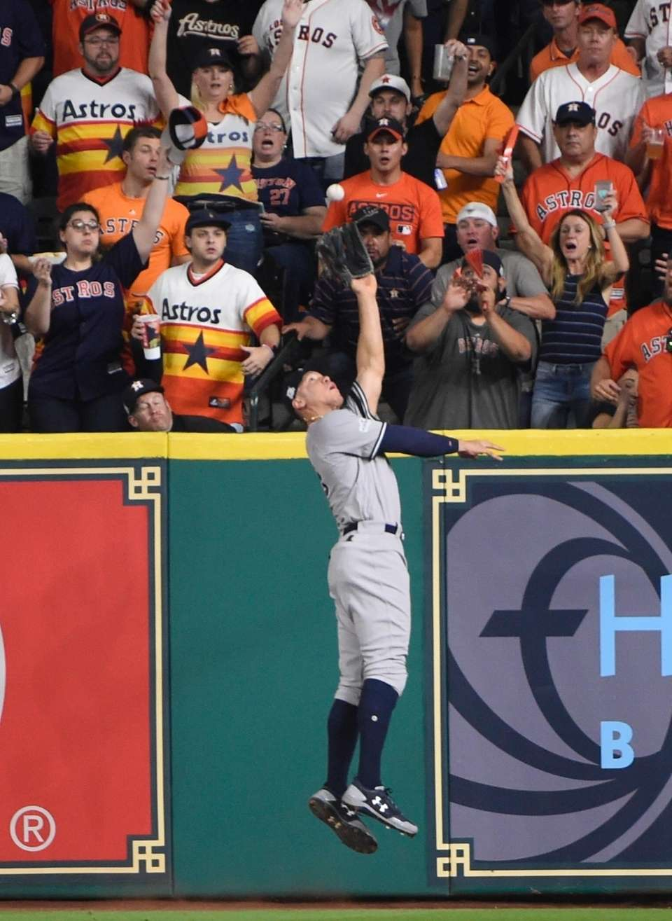 New York Yankees' Aaron Judge catches a long