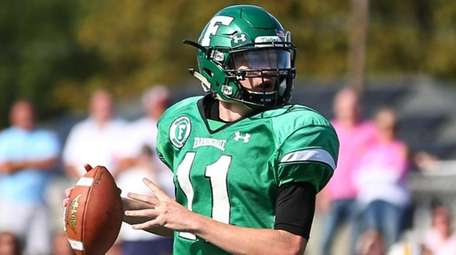 Farmingdale's Kevin Mccormick runs the ball during a