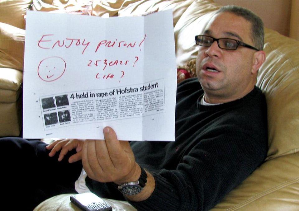 Ramiro Taveras, father of Kevin Taveras, holds a