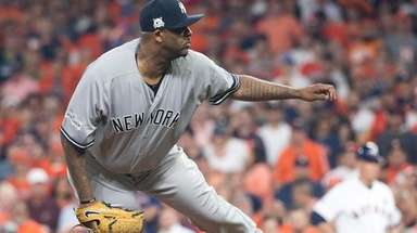 Yankees starter CC Sabathia pitches in the first