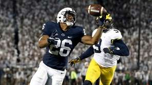Penn State's Saquon Barkley gains control of a