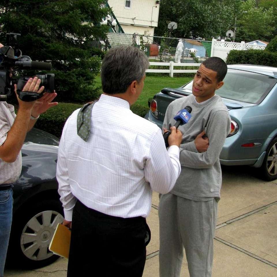 Kevin Taveras speaks to a television news crew