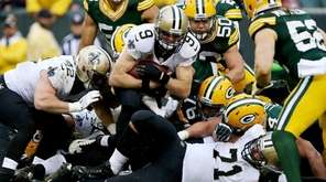 Drew Brees of the New Orleans Saints scores