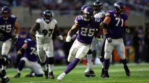 Latavius Murray of the Minnesota Vikings carries the