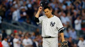 Masahiro Tanakaof the Yankees walks to the dugout