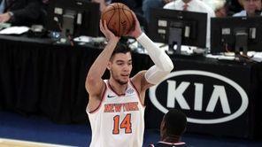 Knicks center Willy Hernangomez looks to pass during