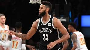 Nets guard Allen Crabbe reacts after a basket