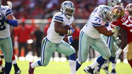 Ezekiel Elliott of the Dallas Cowboys rushes with