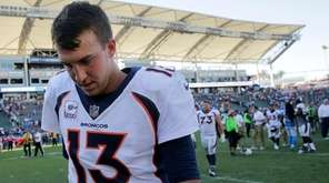 Broncos quarterback Trevor Siemian walks off the field