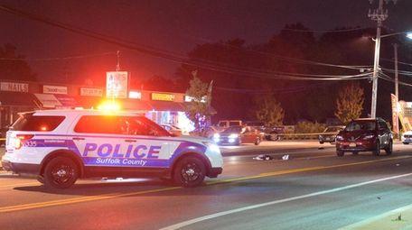 Investigators at the scene where a pedestrian was