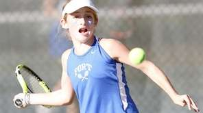 Port Washington's Thea Rabman hits a forehand in