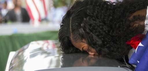 Myeshia Johnson kisses the coffin of her husband,