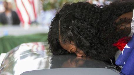 Myeshia Johnson kisses the coffin of her husband,