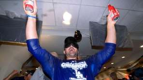 Adrian Gonzalez celebrates in the locker room after