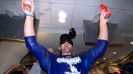 Adrian Gonzalez celebrates in the locker room after