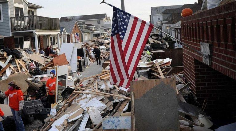 Debris is piled along Michigan Street in Long