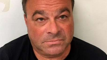 Michael Moskowitz, 53, of West Hampton Dunes, faces