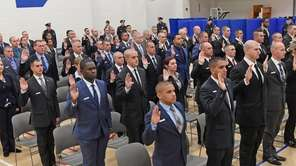 Newly sworn-in Suffolk County police recruits at the