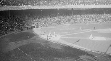 Yankees outfielder Elmer Miller scores in game 2