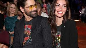 John Stamos and Caitlin McHugh attend Nickelodeon's 2017