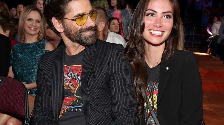 John Stamos gets engaged to girlfriend Caitlin McHugh at Disneyland