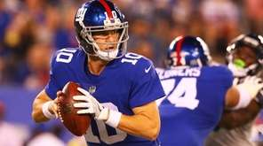 Eli Manning of the Giants looks to pass against the