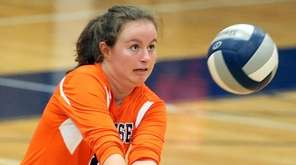 Manhasset's Caroline D. Kelly makes a defensive play