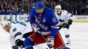 Rick Nash of the Rangers tries to bring