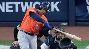 The Astros' Carlos Beltran hits a double during