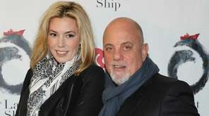 Alexis Roderick and Billy Joel attend the opening