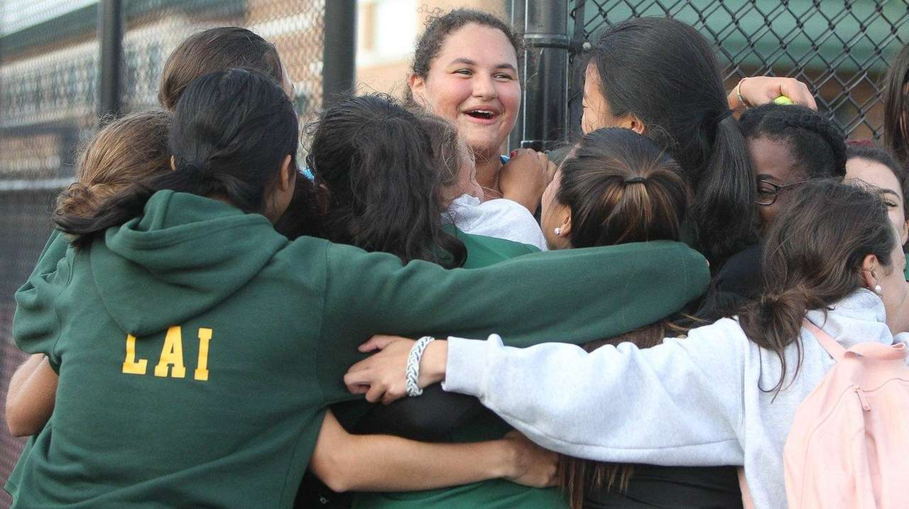 Ward Melville celebrates its win over Half Hollow