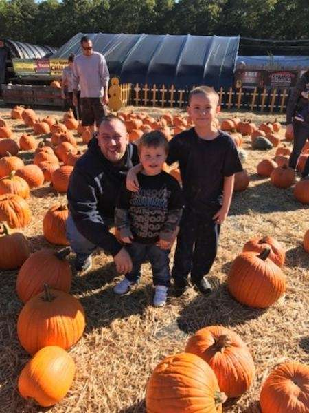Jonathan and Joseph Rosario from Medford picking pumpkins
