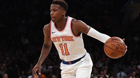 New York Knicks guard Frank Ntilikina controls the